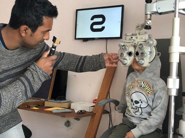 Ravi performing an eye test on Bronte
