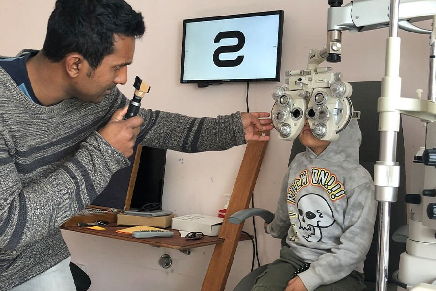 Ravi performing an eye test on Bronte